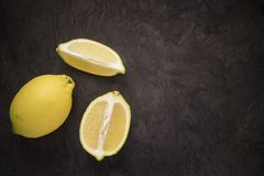 Lemons on a dark background from above Stock Images