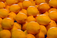 Lemons on display at market Stock Images