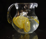 Lemons are falling into the pitcher  Stock Photo