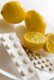 Lemons and flu pills - grippe remedy Royalty Free Stock Photos