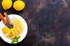 Lemons. Fresh lemons with mint leaves on a table Royalty Free Stock Photo