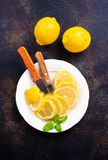 Lemons. Fresh lemons with mint leaves on a table Royalty Free Stock Images