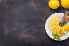 Lemons. Fresh lemons with mint leaves on a table Stock Images