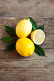 Lemons. Fresh organic lemons on rustic wooden background with copy space Royalty Free Stock Image