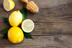 Lemons. Fresh organic lemons on rustic wooden background with copy space Stock Photos