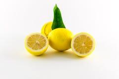 Lemons. Fresh lemons yellow and green on white background Royalty Free Stock Photo