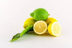 Lemons. Fresh lemons yellow and green on white background Royalty Free Stock Image