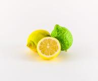 Lemons. Fresh lemons yellow and green on white background Royalty Free Stock Images