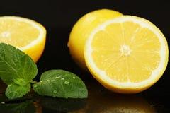 Lemons fruits. On the black background Royalty Free Stock Images