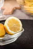 Lemons glass container Royalty Free Stock Photos