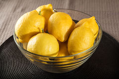 Lemons glass container Stock Images