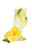 Lemons in a glass with water isolated on white Stock Photography
