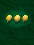 Lemons on a green background Stock Photos