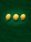Lemons on a green background Stock Photos