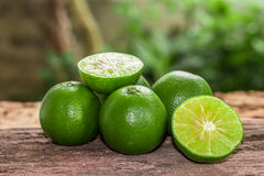Lemons. Green  from the garden on wooden background, Select focus, Soft focus and blur Royalty Free Stock Photography