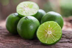 Lemons. Green  from the garden on wooden background, Select focus, Soft focus and blur Stock Images