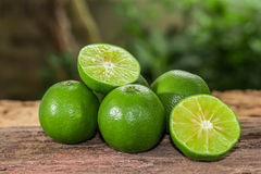 Lemons. Green  from the garden on wooden background, Select focus, Soft focus and blur Royalty Free Stock Photos