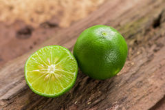 Lemons. Green  from the garden on wooden background, Select focus, Soft focus and blur Royalty Free Stock Images