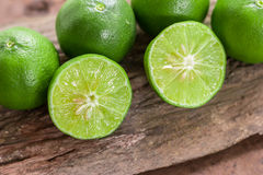Lemons. Green  from the garden on wooden background, Select focus, Soft focus and blur Royalty Free Stock Image