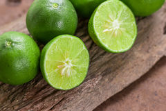 Lemons. Green  from the garden on wooden background, Select focus, Soft focus and blur Stock Photo