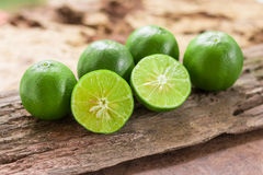 Lemons. Green  from the garden on wooden background, Select focus, Soft focus and blur Stock Photos