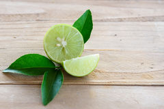Lemons with green leaf stock photo