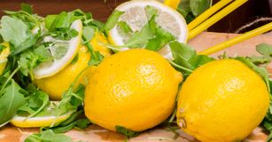 Lemons and green salad Royalty Free Stock Images
