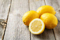 Lemons. On grey wooden background stock photography