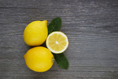 Lemons on grey wooden  table. Royalty Free Stock Photo