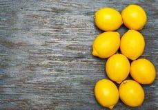 Lemons group on woogen table. Royalty Free Stock Photo