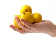 Lemons in hand Stock Photos