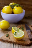 Lemons with herb thyme Royalty Free Stock Images