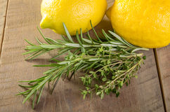 Lemons and herbs on a wooden table Royalty Free Stock Image