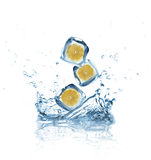 Lemons with Ice cubes splashing into the water Royalty Free Stock Photography