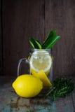 Lemons in in jar with lemon reamer Royalty Free Stock Photos