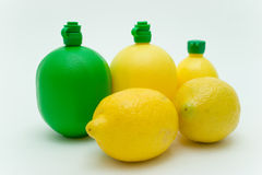 Lemons and juice Containers Stock Photo