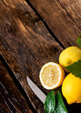 Lemons and knife. On wooden board. Royalty Free Stock Photography