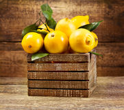 Lemons with leaf in wooden box Royalty Free Stock Photo