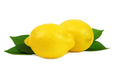 Lemons and leaves. Two lemon isolated on white background Royalty Free Stock Photo