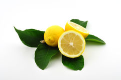 Lemons with leaves isolated. Three lemons with leaves and blossom isolated on white Stock Photos