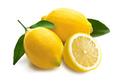 Lemons with leaves on a white background Stock Photo
