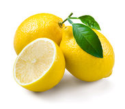 Lemons with leaves on a white background. Royalty Free Stock Photo