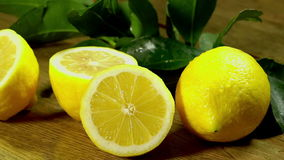 Lemons with leaves on wooden boards. stock footage