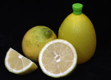 Lemons and lemon juice. With black background stock photos