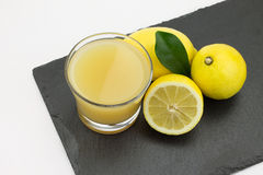Lemons and lemon juice Royalty Free Stock Photos