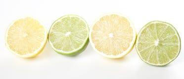 Lemons and lime. Fresh halfs of limes and lemons Royalty Free Stock Images