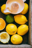 Lemons, lime, orange in a wooden box Stock Photos