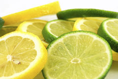 Lemons and limes. Sliced on a white background Stock Photography