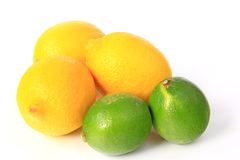 Lemons and limes. Lemons (Citrus x limon) and limes, isolated against white background Royalty Free Stock Photos