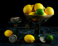 Lemons and limes on vintage old fashion pound scales Royalty Free Stock Photography